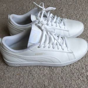 All white Puma sneakers
